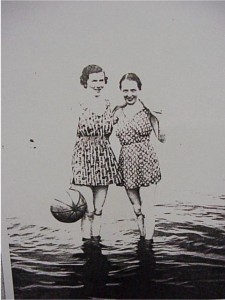 two unidentified ladies standing in the water