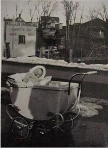 unidentified baby in carriage outside killaloe carding mill