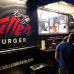 Placing orders at the Killer Burger Food Truck at night