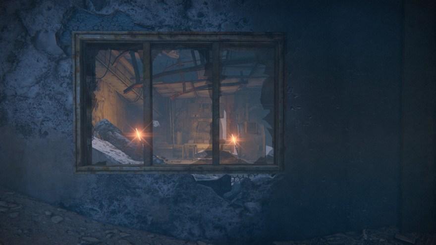 a window framing a room of warm lights