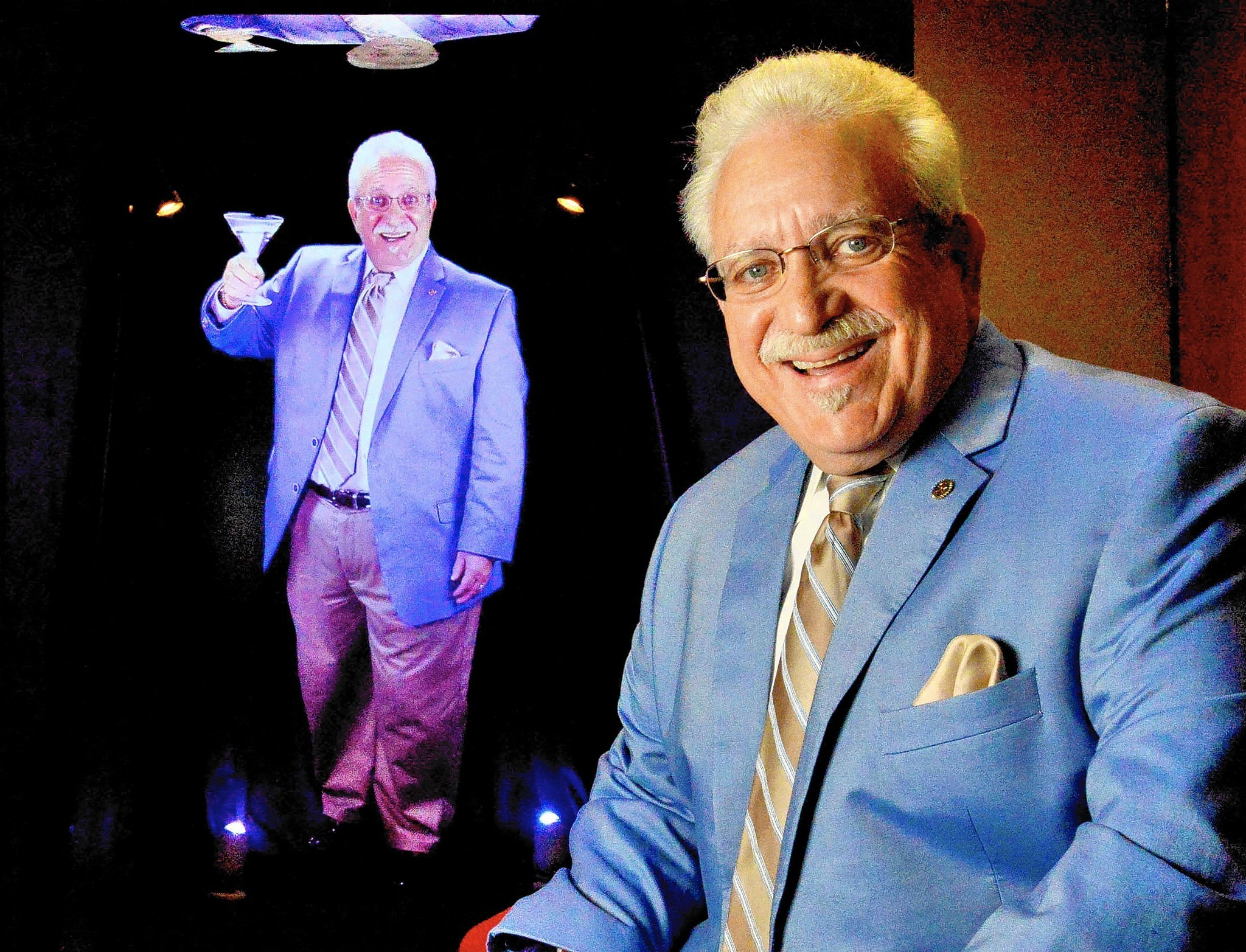 Carl Minardo, CEO of AIM Holographics Inc. with his funeral hologram