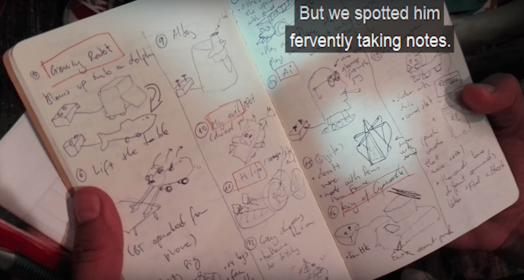 "Cuartielles scribbled down notes on all the ""heboi"" robots during the competition."