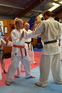 Lauren from Ballina Dojo works with Sempai James Campbell from Turramurra Dojo.