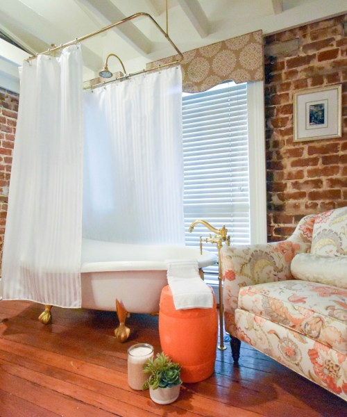 mildew resistant washable fabric shower curtain liner on clawfoot tub in luxury historic inn