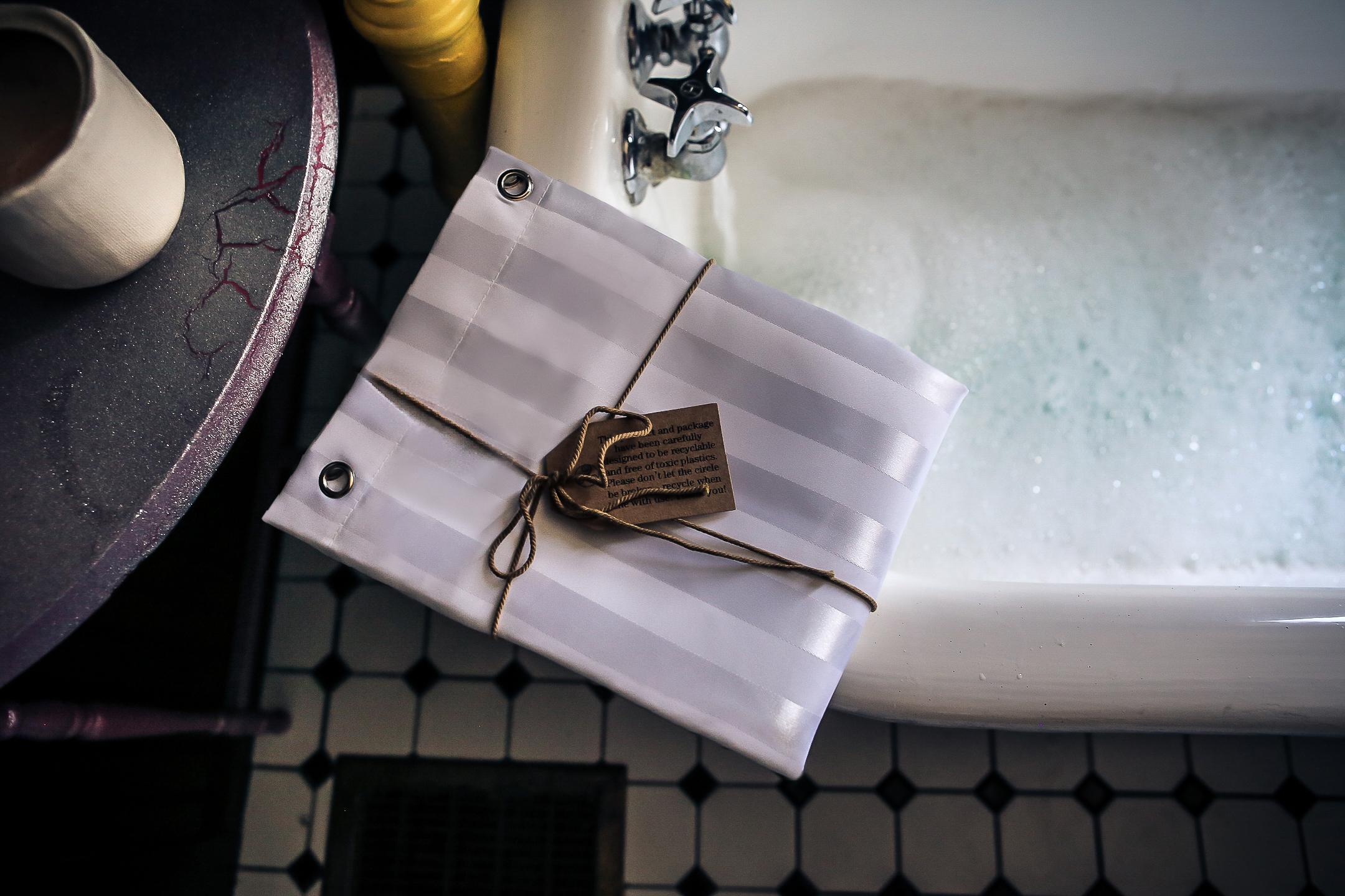 Shower Curtain Liner Displayed On Ledge Of Clawfoot Bathtub Bubble Bath