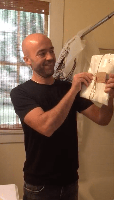 airbnb owner unboxing video of the shower curtain liner by kimberly-carr home designs
