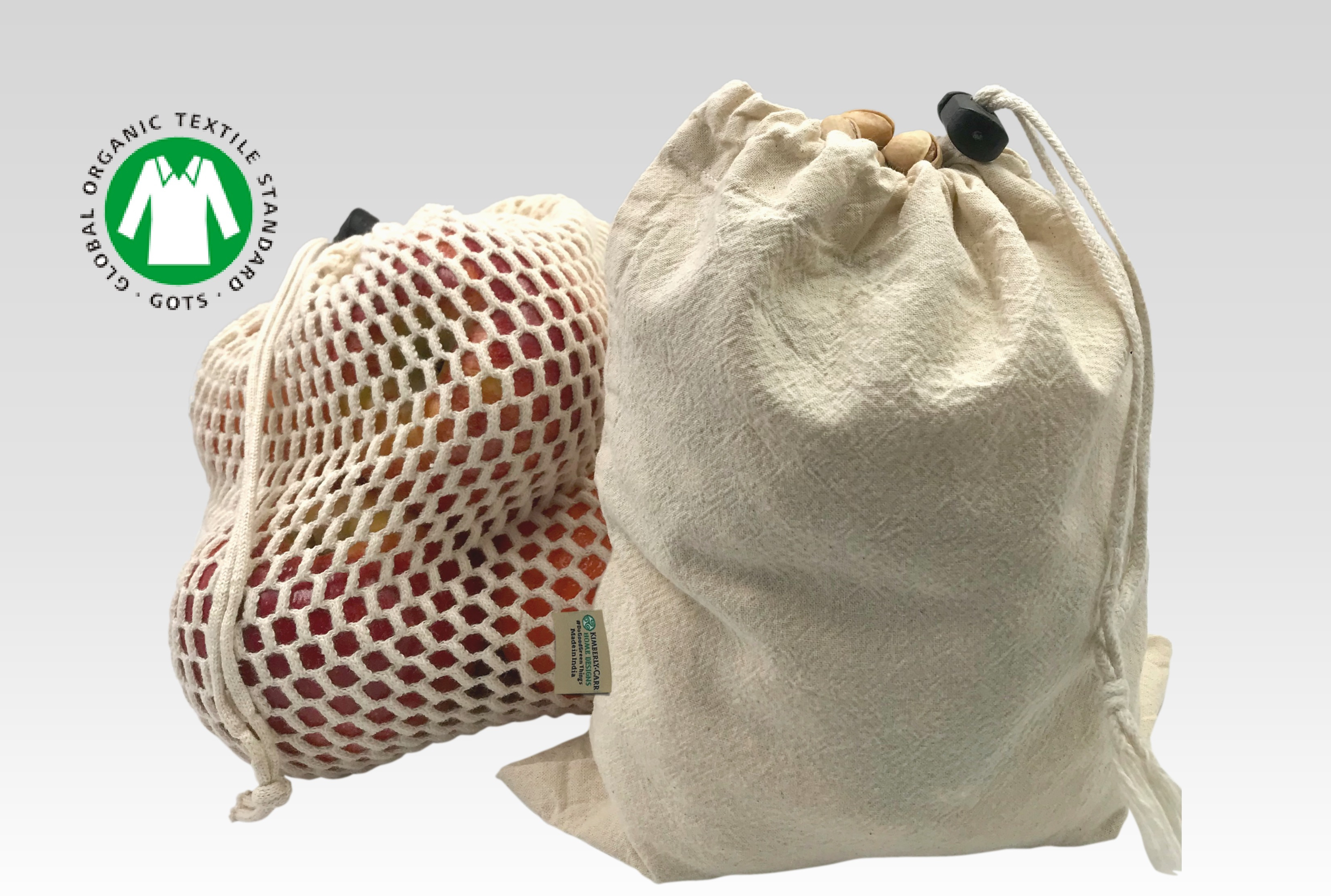 organic cotton mesh and muslin reusable produce bags filled with apples and pistachios