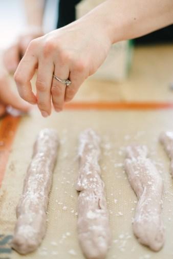 making salt water taffy for engagement photo shoot