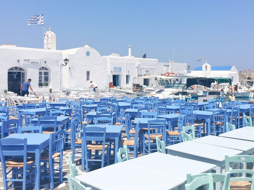paros greece naousa square dinner blue chairs ombre