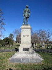 A monument to Jackson. A white pedestal with a statue of Jackson on top.
