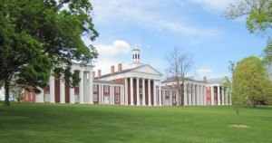 Colonnade building at Washington and Lee University with green grass in foreground
