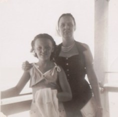a black and white photo of a young girl and her mother