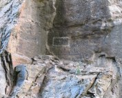 rock face with initials G.W. carved into it, boxed in with white paint