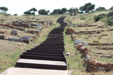 steps leading upward with ruins of foundations on either side