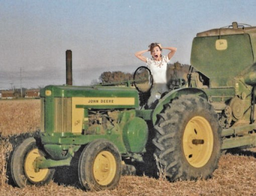 scared girl learning to drive old John Deere tractor
