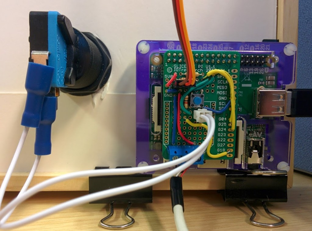 Here's the back with an arcade machine button and the wiring to the servo