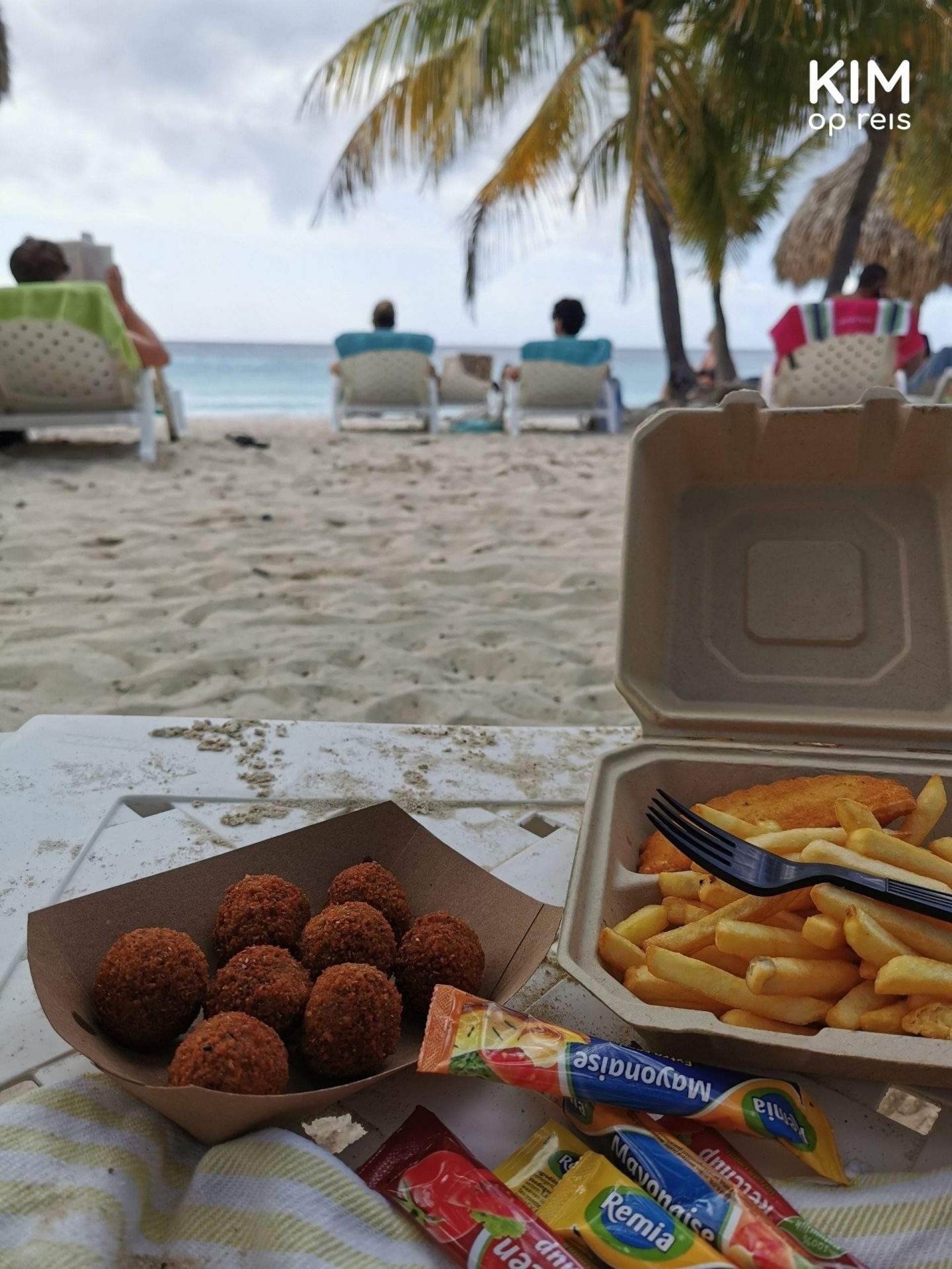 Fries and bitterballen on the beach Curaçao: picture of junk food on a beach lounger