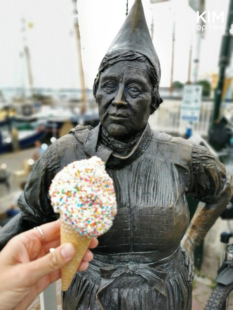 Fisherwoman's wife ice cream disco dip - a statue of a fisherwoman with a hand holding an ice cream