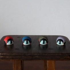 お辞儀福助さんのフェーブ Feve of Bow Fukusuke  Size:各2.0×2.0×1.8cm/Color : red , blue , green , purple/Materials: porcelain  ¥600+Tax  FEVES-42赤 EVES-43青 FEVES-44緑 FEVES-45紫