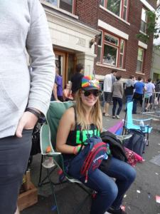 Me at the parade, fake smiling and trying not to vomit