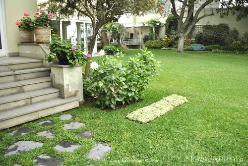 Note the quirky addition of the flower carpet - one of several punctuation dashes breaking the monotony of a vast lawn.