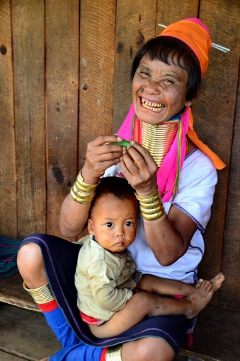Kayan lady performing her song using a leaf