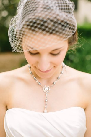 Bride wears a vintage style birdcage veil on her wedding day