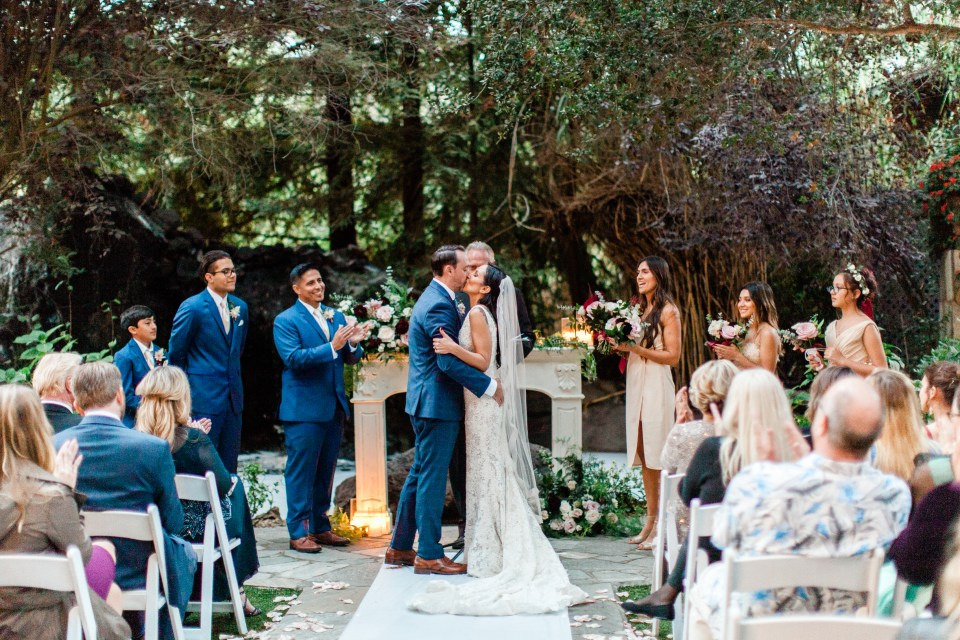 Bride and Groom seal their marriage with a kiss at Calamigos Ranch Wedding