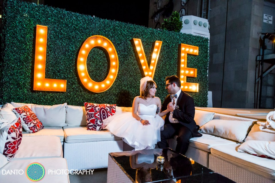 Bride and Groom married on Los Angeles rooftop with Love marquee