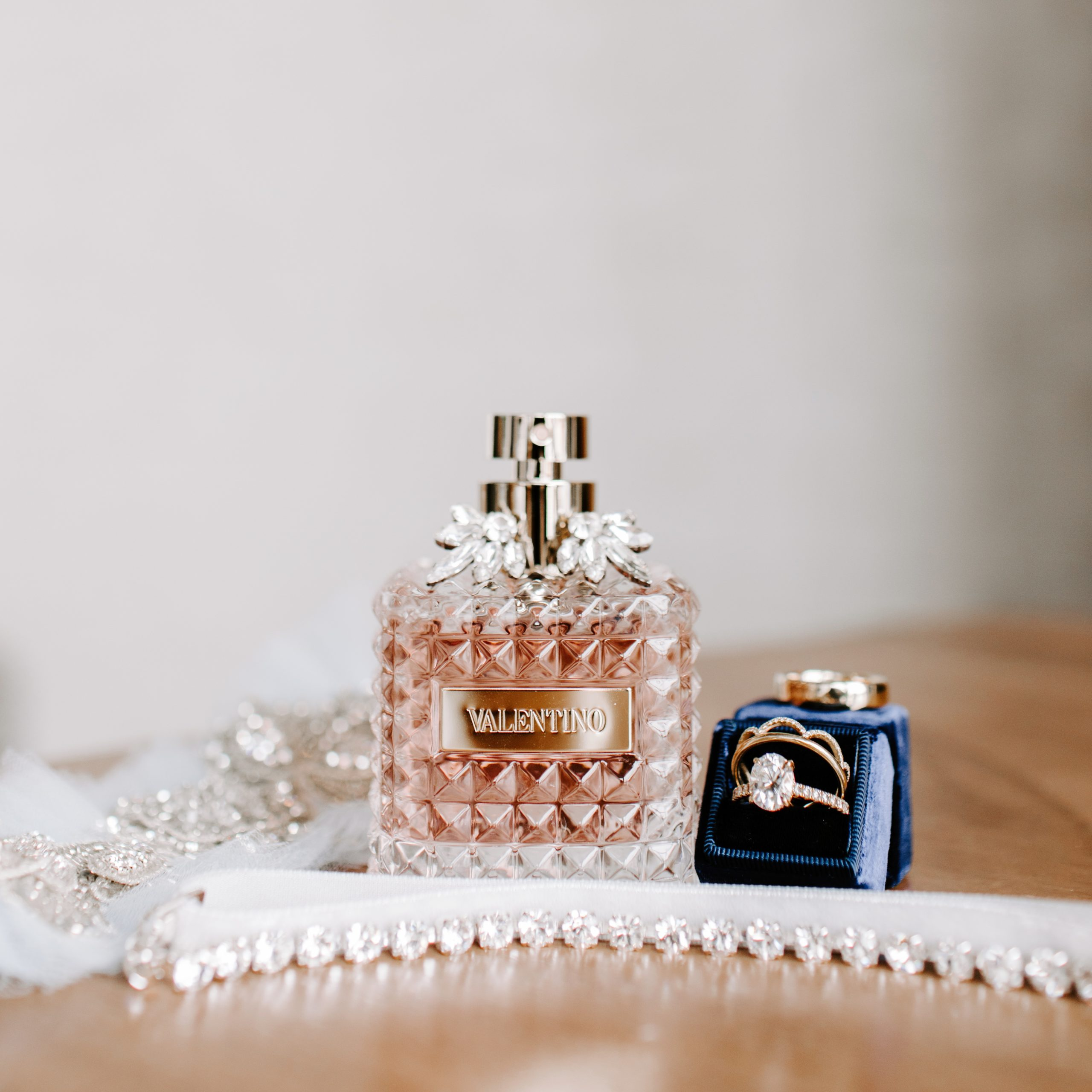 Bridal perfume and jewelry details