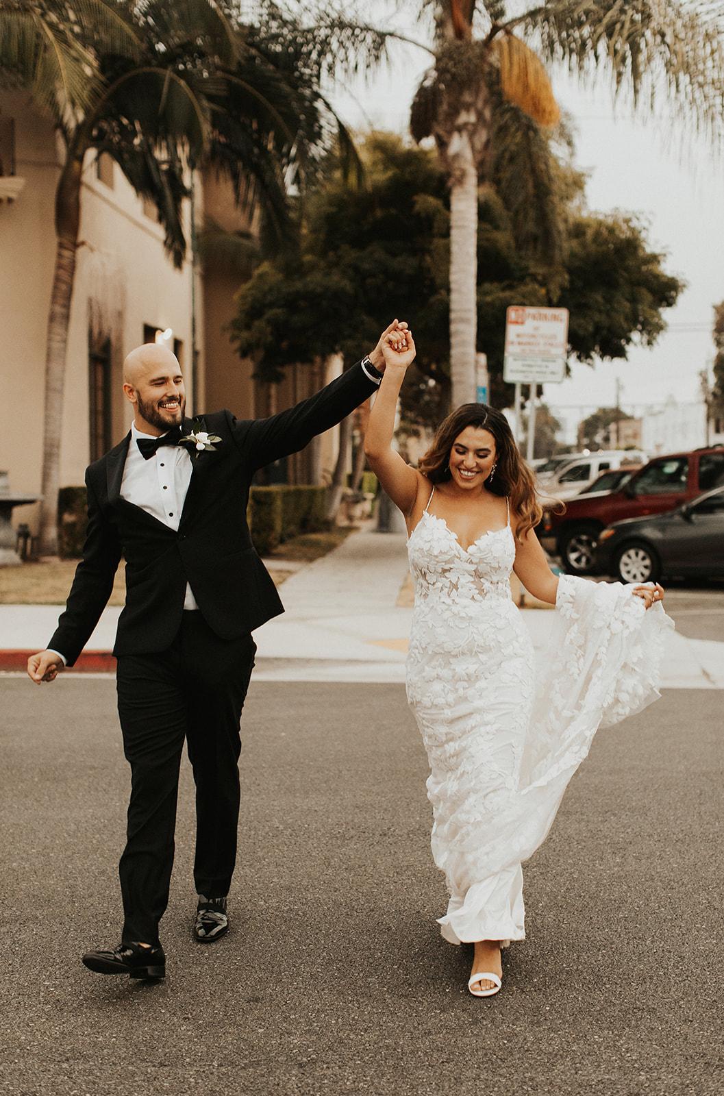 Bride and Groom dance in Los Angeles streets