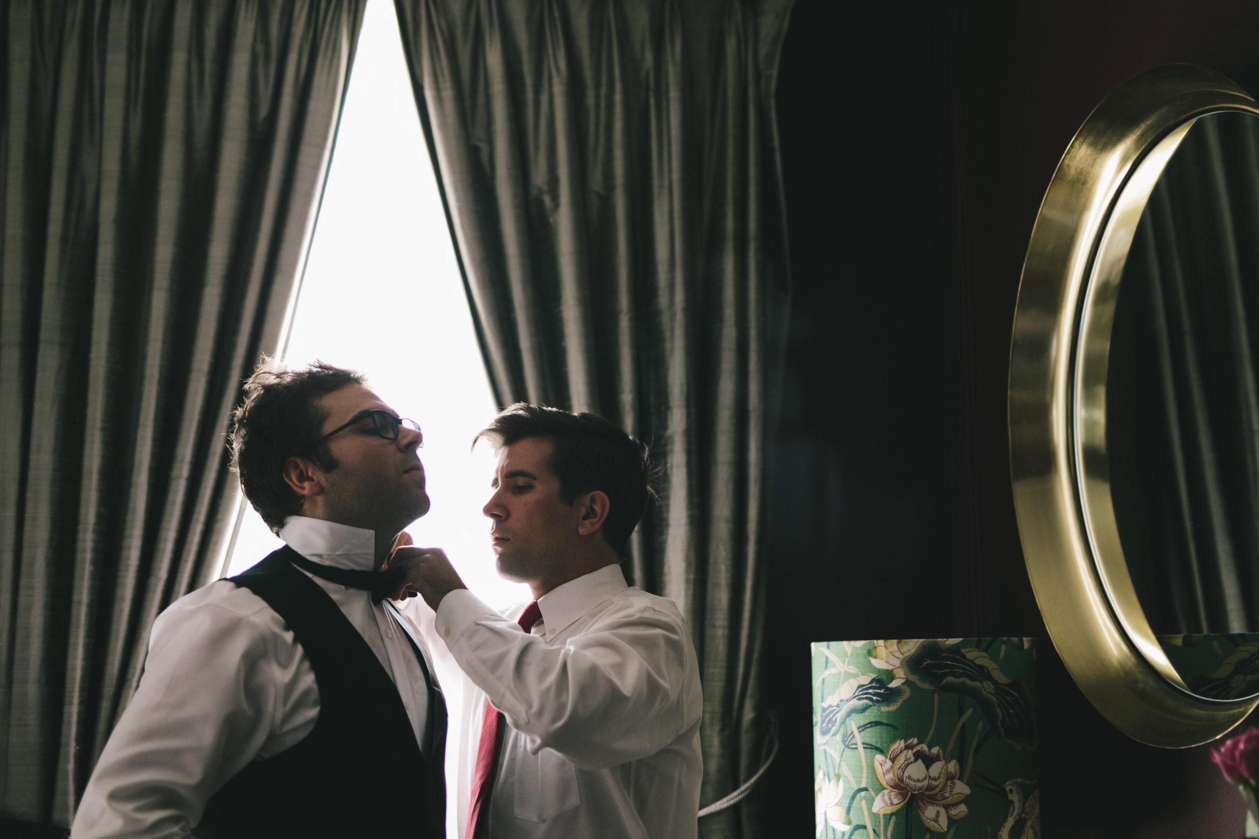 Best man adjusts grooms tie