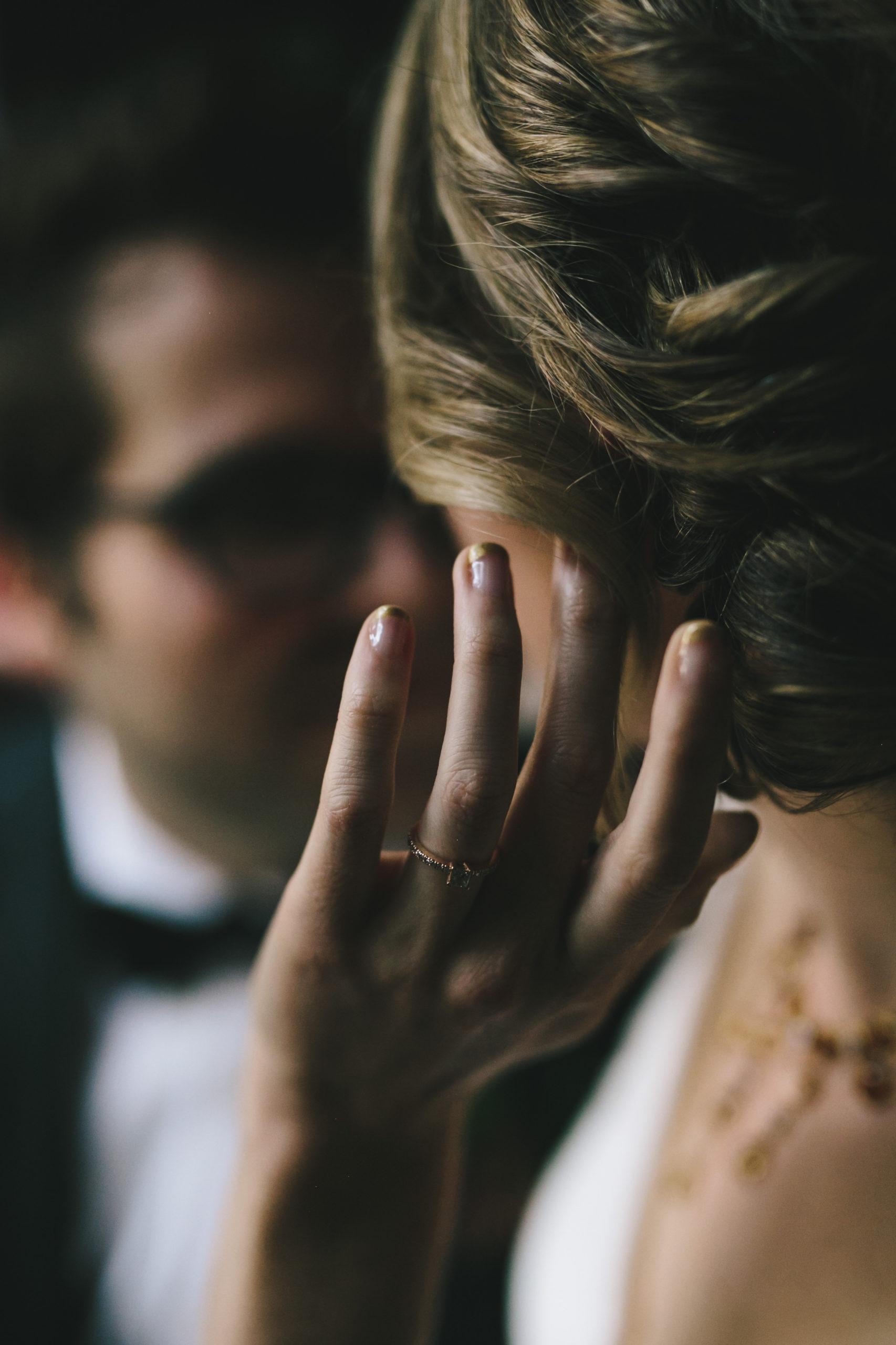 Bride shows off vintage wedding ring