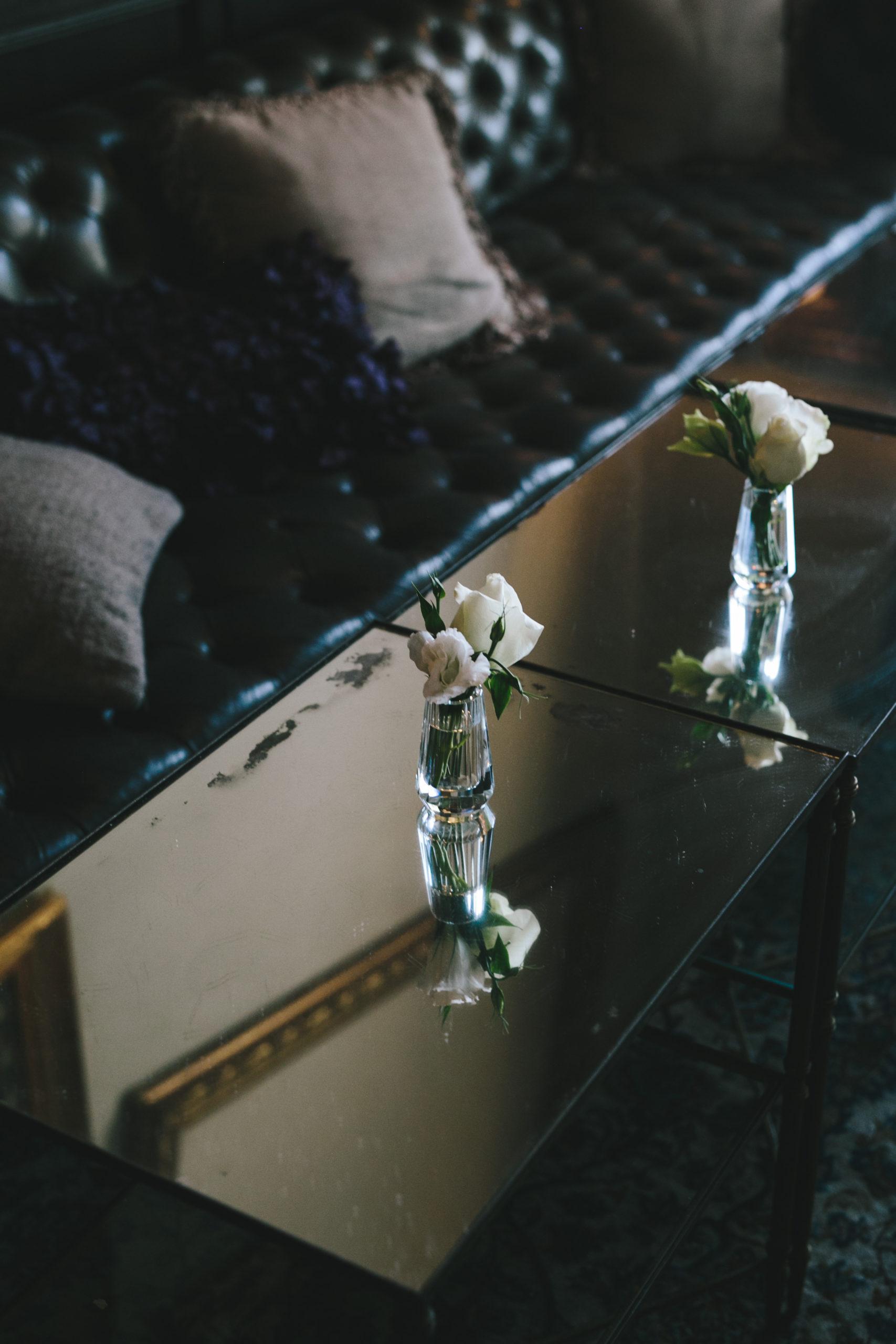 Small bud vases at wedding