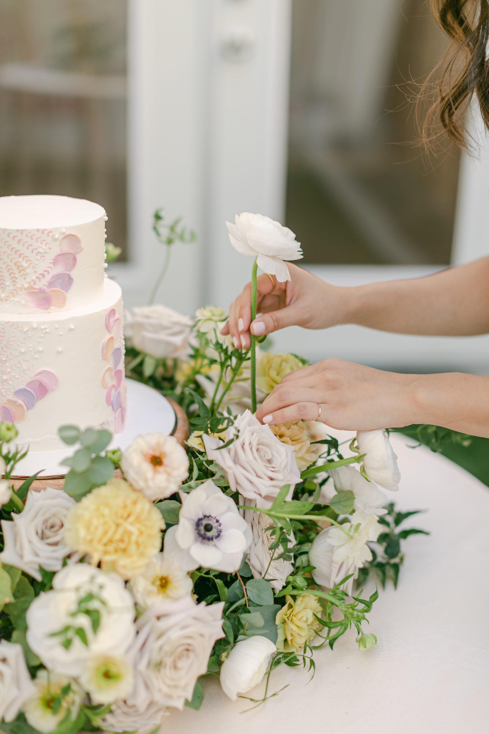 cake with springtime wedding flowers