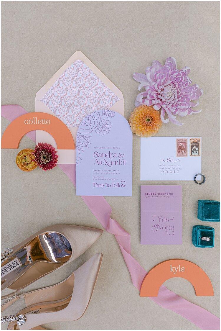 vibrant and modern wedding paper goods flatlay