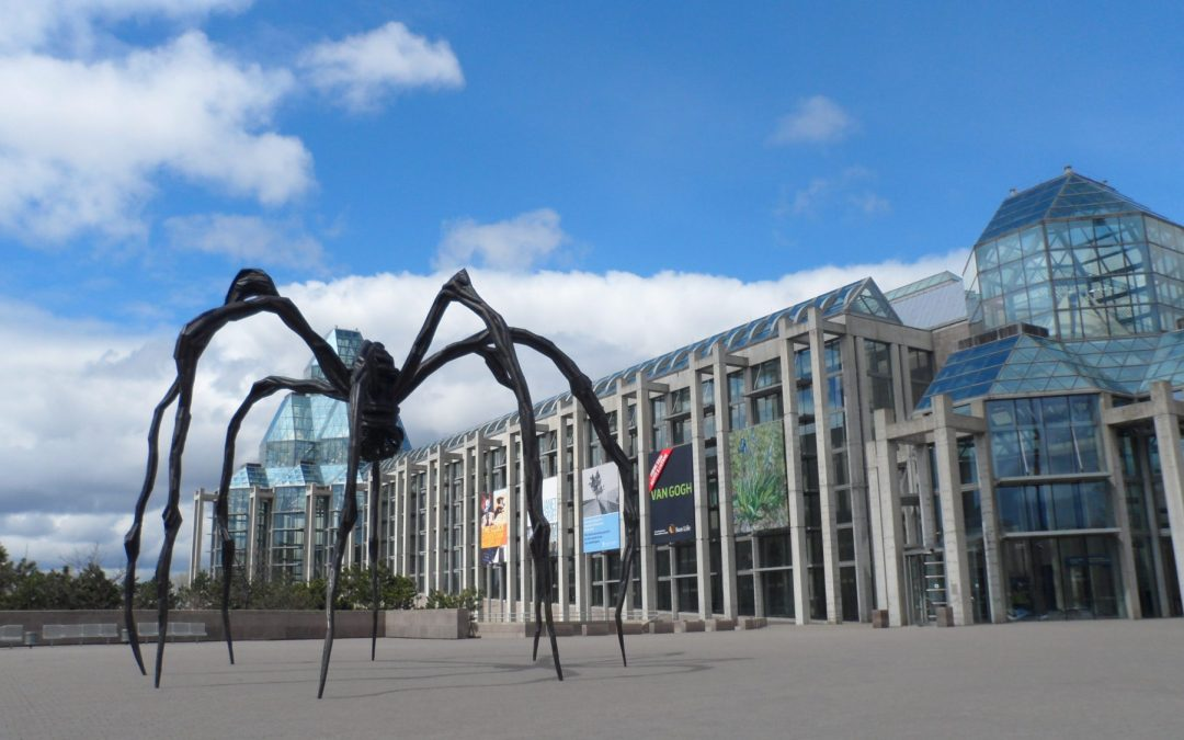 A picture of the National Art Gallery of Canada taken from the outside next to the spider sculpture