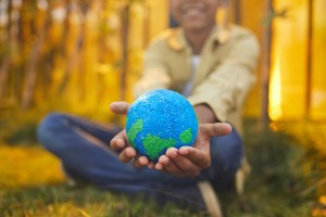 Smiling African-American Boy Holding Planet