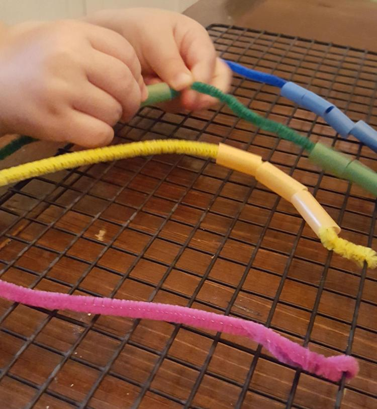 pipe cleaner fine motor threading activity for toddlers