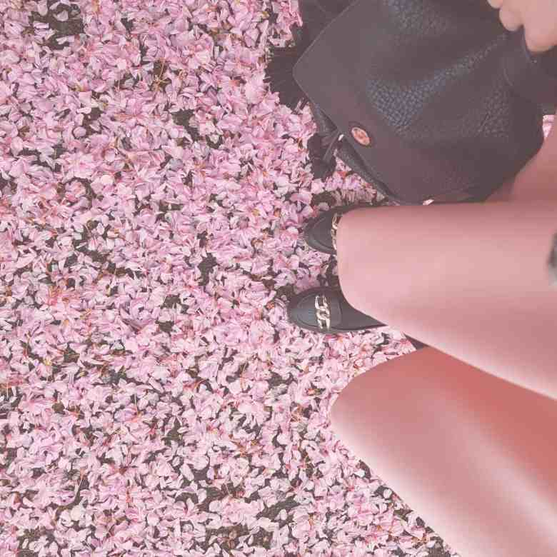 pink skirt, spring flowers, black bag, style