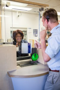 Nate Higby signals to customer service staff that he can hear the staff person through the loop system.