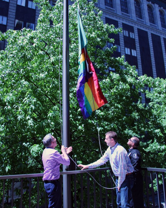 Dow Constantinte and Joe McDermott raise the Pride flag at King County's administration building June 23, 2017.