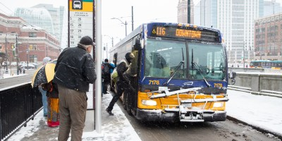 Riders board during the 2019 snow storm