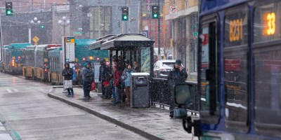 Snow flurries around buses at stops in downtown Seattle