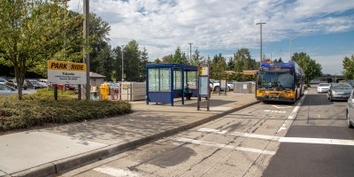 Blue skies and a bus pulling up to a stop at Tukwila P&R