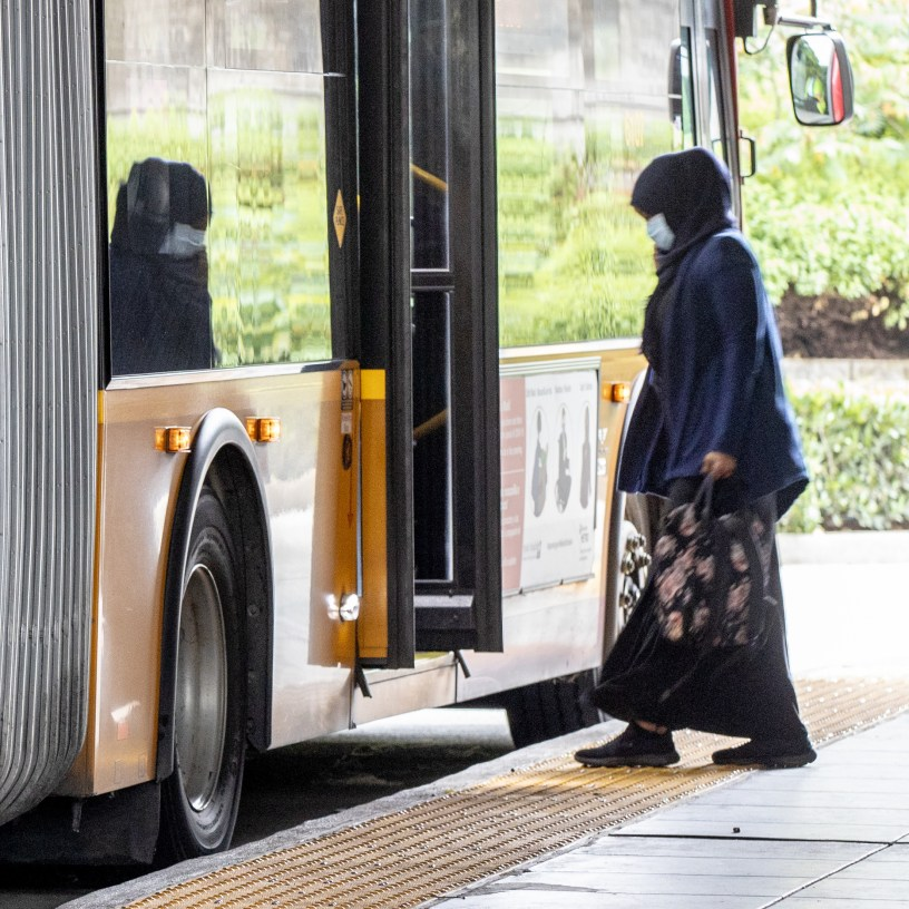 A rider boards a Metro bus