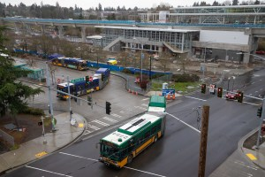 Buses turn on NE 103rd Street in Northgate near the Sound Transit Link light rail station