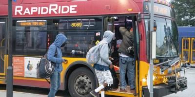 Passengers boarding RapidRide coach