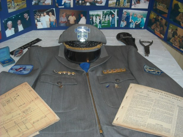 A display at Jack's memorial shows his Greyhound uniform, artifacts of his career, and a photo posterboard display
