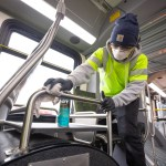 The Vehicle Maintenance team cleaning coaches